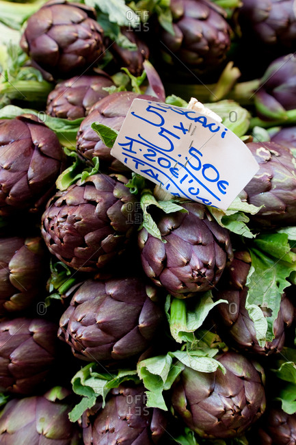High angle close up of artichokes on market stall, Bologna, Emilia-Romagna, Italy.