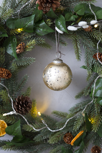 Christmas decorations, close up of golden bauble on Christmas wreath.