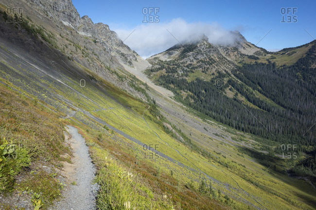 View of the Pacific Crest Trail through vast alpine valley and meadow, autumn