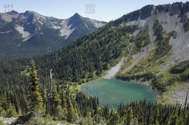 View of Hopkins Lake in a valley from the Pacific Crest Trail