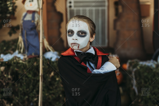 Close up of boy dressed as Dracula posing in costume at Halloween