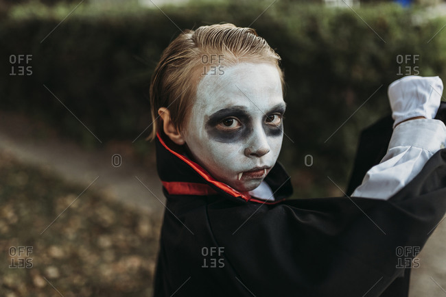 Close up of young boy dressed in Dracula costume on Halloween