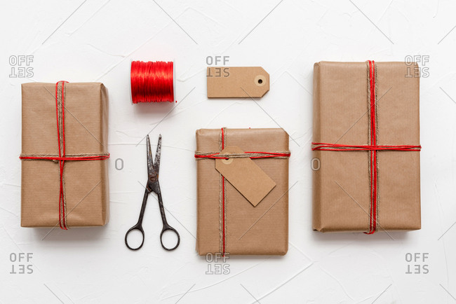 Christmas gift boxes wrapped in craft paper over white background prepared for celebrating festive holiday season