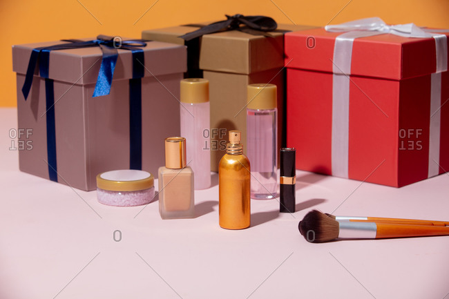 Holiday gifts and cosmetics on a table