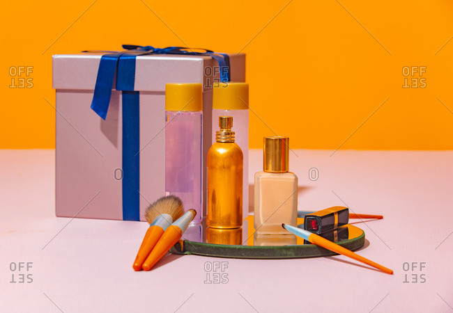 Holiday gifts and cosmetic items on a table