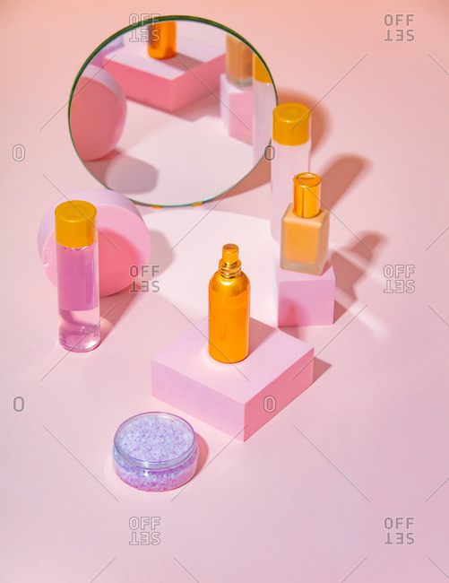 Perfume, oil and cream on a stands near mirror Cosmetics