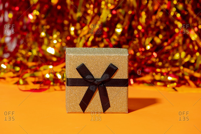 Classic gift box on a gold and red background