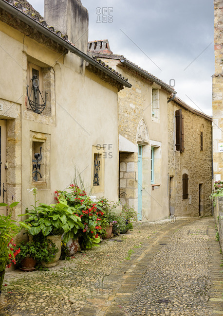 Puy-l'Eveque, France - September 16, 2017: Old homes and cobblestone street in the mediaeval town of Puy-l'Eveque in the Lot department within the Occitanie region of southern France