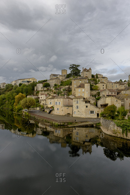 The mediaeval town of Puy-l'Eveque on the Lot River in the Occitanie region of southern France