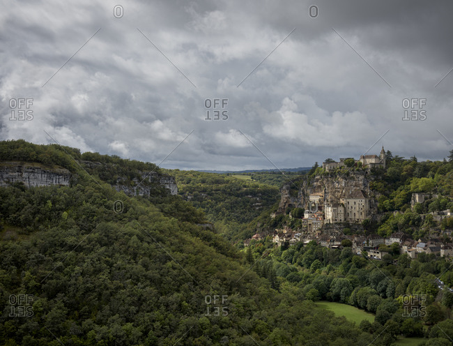 View of the old holy cliffside town of Rocamadour in the Alzou Canyon in the Lot department within the Occitanie region of southern France
