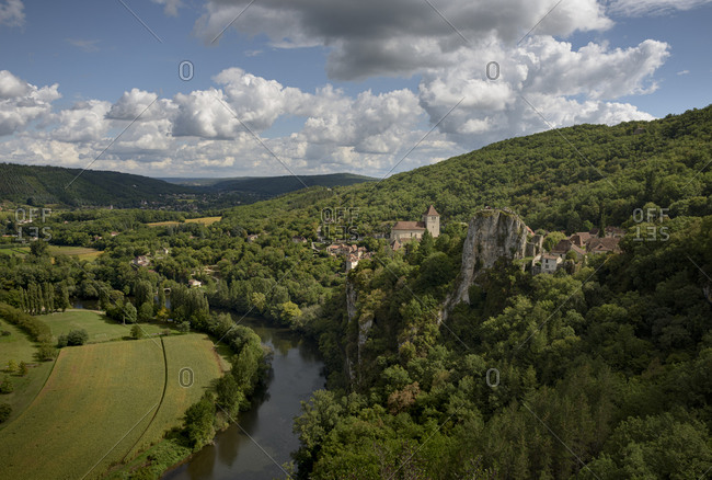 View over the medieval town of Saint-Cirq-Lapopie towering above the Lot River in the valley of the Lot in the Occitanie region in France
