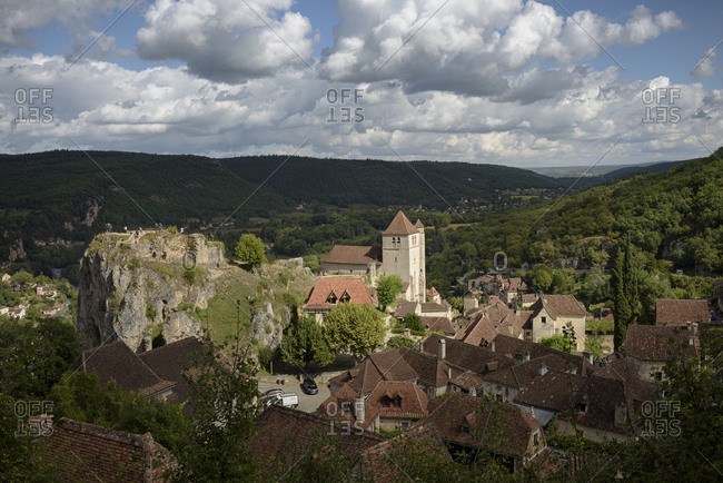 Bird's eye view over homes and buildings in the medieval town of Saint-Cirq-Lapopie in the valley of the Lot in the Occitanie region in France