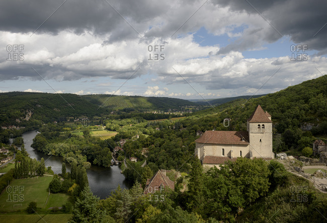 View over the medieval town of Saint-Cirq-Lapopie and the Lot River in the valley of the Lot in the Occitanie region of France