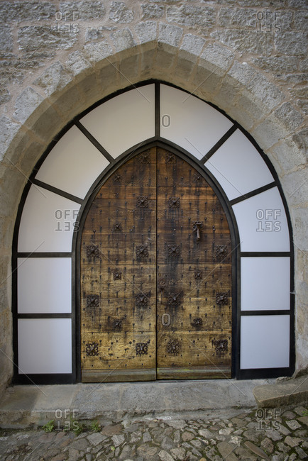An old beautiful door and a renovated entrance in the medieval town of Saint-Cirq-Lapopie in the Lot Valley in the Occitanie region in Franc
