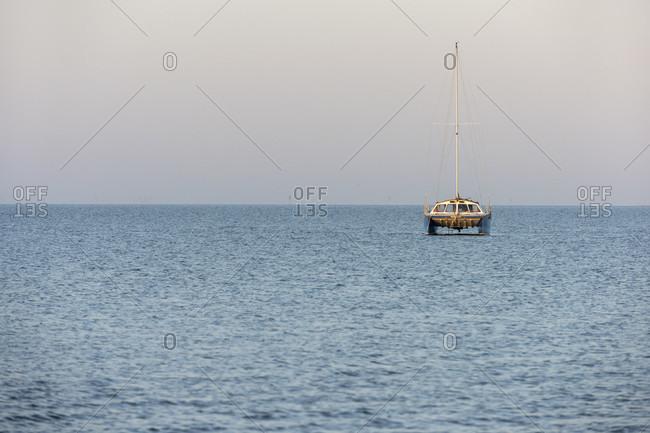 Germany, Lower Saxony, East Frisia, Juist, catamaran at anchor.