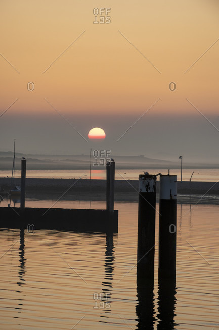 Germany, Lower Saxony, East Frisia, Juist, morning hour in the harbor.