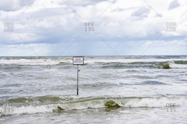 Germany, Lower Saxony, East Frisia, Juist, warning of flushing field.