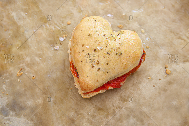 Heart-Shaped Pizza Dough Sandwich with Tomato, Mozzarella and Basil, High Angle View