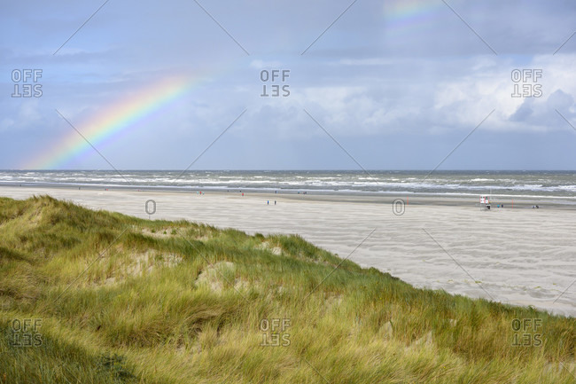 Germany, Lower Saxony, East Frisia, Juist, the beach with a rainbow.