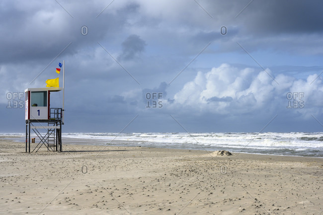 Germany, Lower Saxony, East Frisia, Juist, beach supervisor with flags raised.
