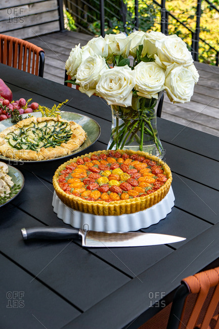 Tomato and Zucchini Tarts on Table in Outdoor Setting