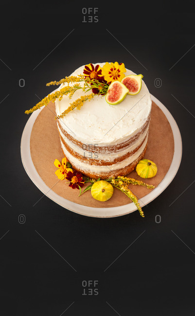 High Angle View of Vanilla Layer Cake Decorated with Edible Fresh Flowers and Fruit