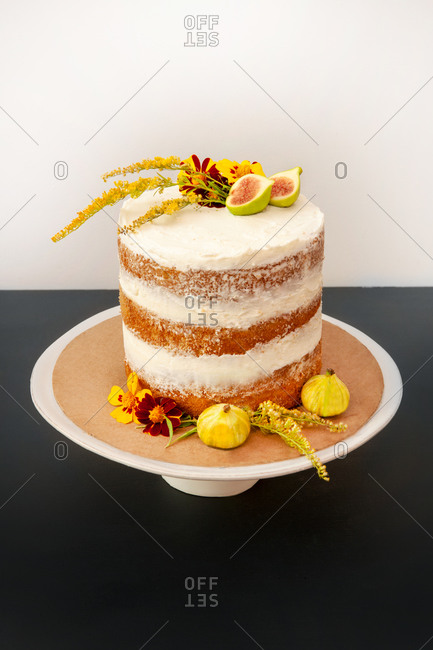 Vanilla Layer Cake Decorated with Edible Fresh Flowers and Fruit