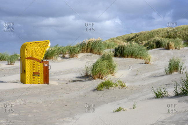 Germany, Lower Saxony, East Frisia, Juist, beach chairs isolated on the edge of the dunes.