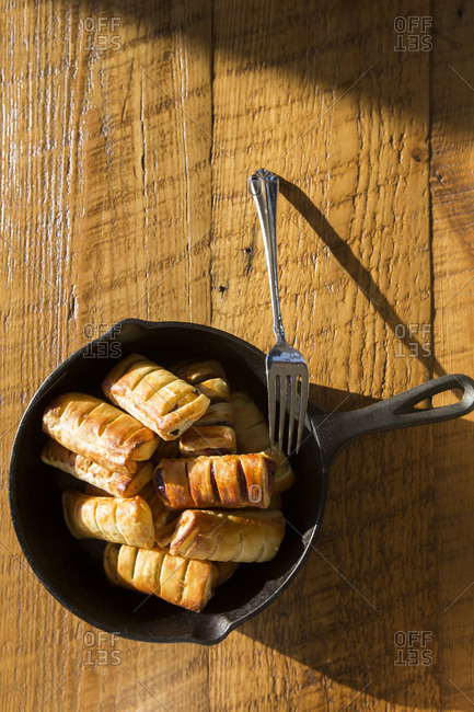 High Angle View of Apple Pastries with Fork in Cast Iron Skillet