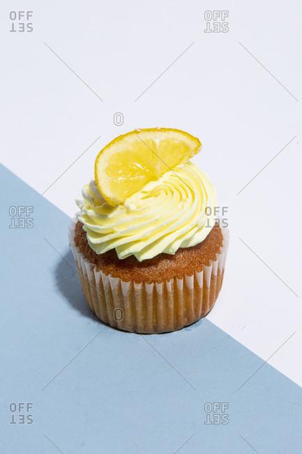Lemon Cupcake on Blue and White Background