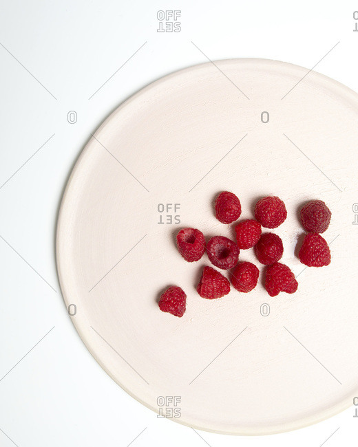 High Angle View of Raspberries on Cropped White Plate