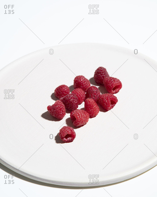 Raspberries on Cropped White Plate