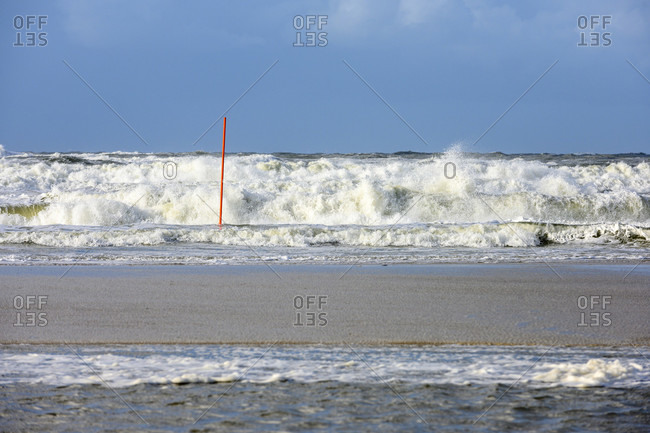 Germany, Lower Saxony, East Frisia, Juist, churned North Sea in stormy weather.