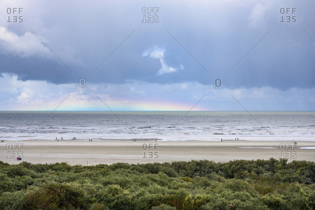 Germany, Lower Saxony, East Frisia, Juist, very flat rainbow over the North Sea.