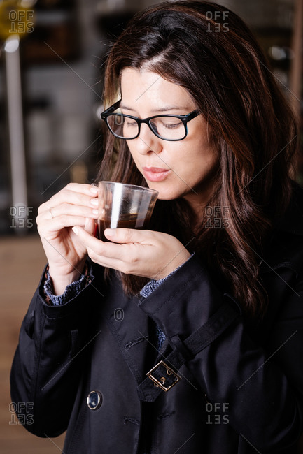 Calm female relaxing in cafe in morning and enjoying delicious hot drink