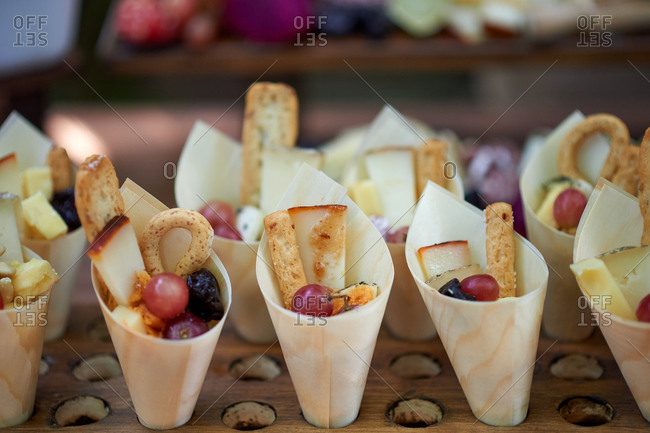Traditional tasty appetizers arranged on wooden table prepared for celebrating of festive event