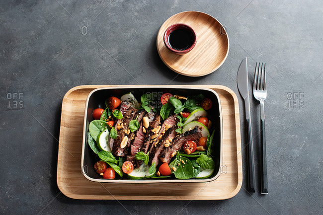 From above beef Thai salad on dark background