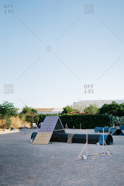 Set of various agility equipment for dogs training and dressage installed on outdoor ground