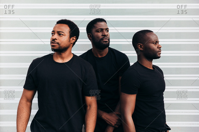 Black cool guys posing over white background looking at camera