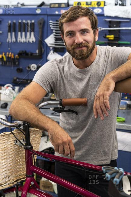 Mechanic leaning on a bicycle