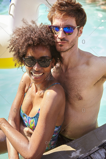 Young couple embracing in the swimming pool