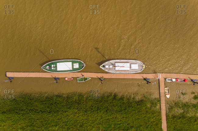 Aerial view of boats moored on the Sado river at Alcacer do Sal, Portugal.