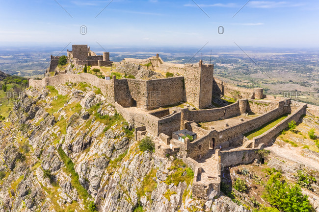 Aerial view of Santa Maria de Marvao perched above a cliff overlooking the countryside, Portugal.