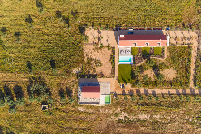 Aerial view of private residence with pool surrounded by countryside, Albernoa, Portugal.