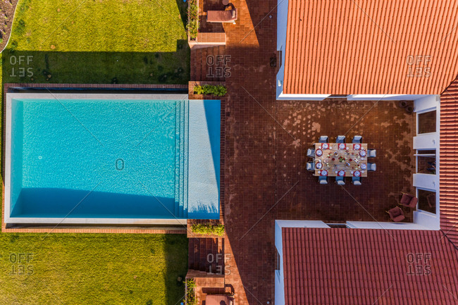 Aerial view of house and swimming pool with outside table laid, Albernoa, Portugal.