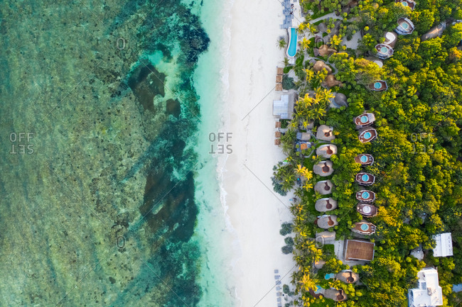 Aerial view of bungalow resorts on the Tulum coast in Mexico.