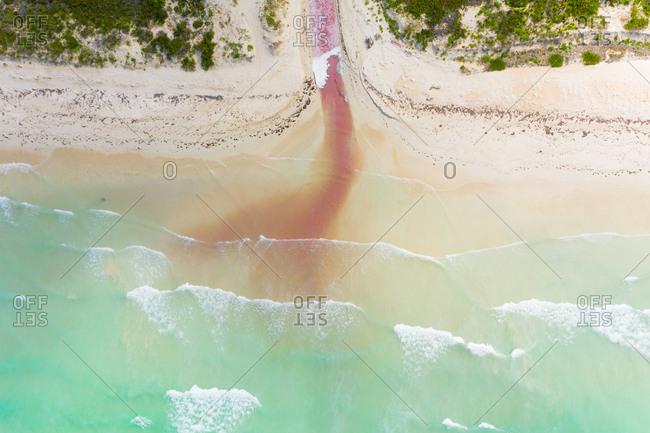 Aerial view of river exiting Las Coloradas lagoon into the sea, Yucatan, Mexico.