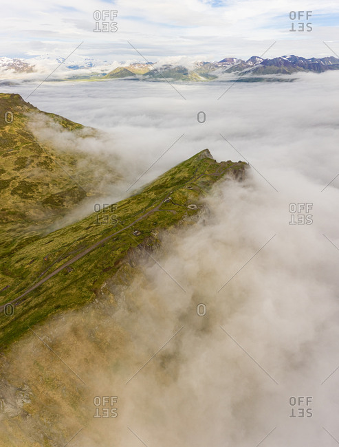 Aerial view of misty mountains surround ing the bay of Unalaska, Alaska, USA.
