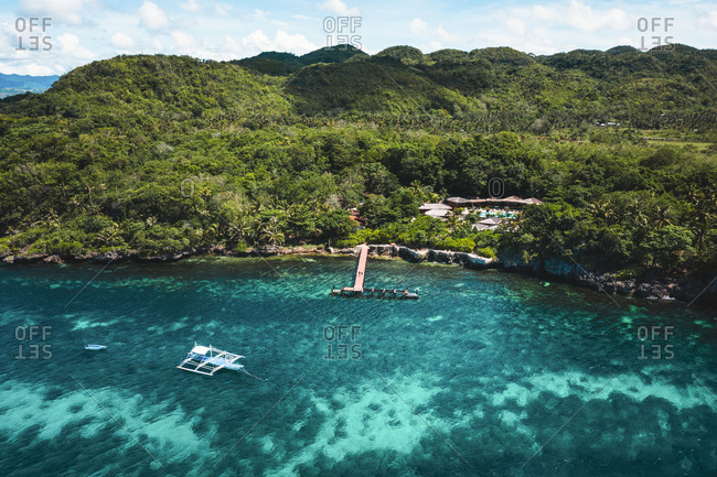 Aerial view of pontoon and pump boat along the coast of Bohol, the Philippines.
