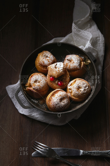 Baked stuffed apples in a cast iron skillet without handle